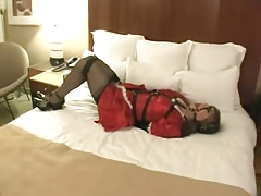 Maid in hotelroom bondaged on bed