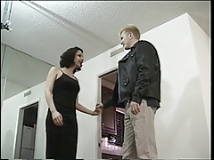 Black haired tranny gets cock swallowed by horny guy