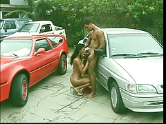 Hot Spanish tranny gets fucked outside on a car, gets a facial
